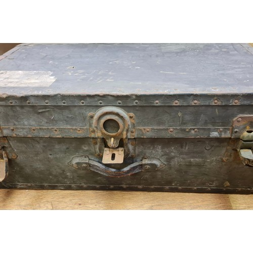 765 - A WW2 Officer travelling trunk (well used) with leather straps, 76x41x30cm