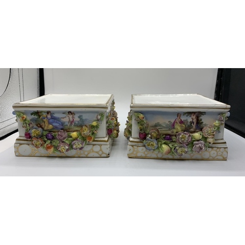799 - A pair of Minton ornate ceramic stands with added floral garlands. One has a surface crack on top. 1...