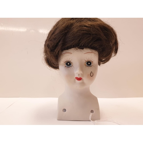813 - Five Bisque Porcelain Dolls Heads 4 of which have Embossed German Marks.