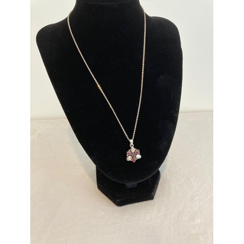 806 - Silver stone set pendant and chain. Pendant having dark pink tourmaline stones interspaced with silv...