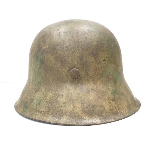 13 - WW2 German M42 Normandy Helmet. This helmet is a typical post 1943 variant in slate grey workshop pa...