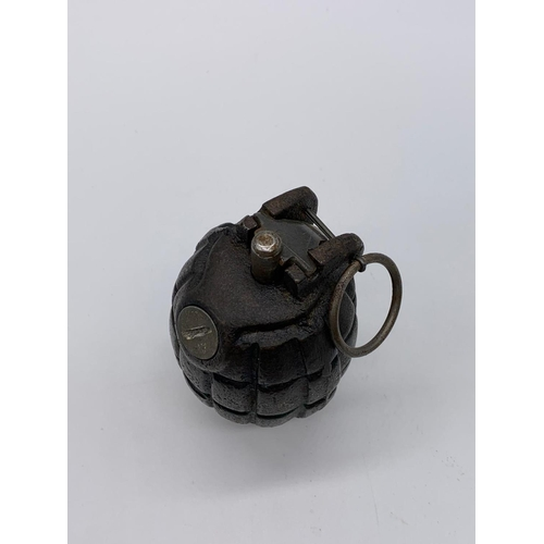 74 - INERT WW2 No 36 Mills Grenade. Base is dated 1943. Made by E.F South Africa.