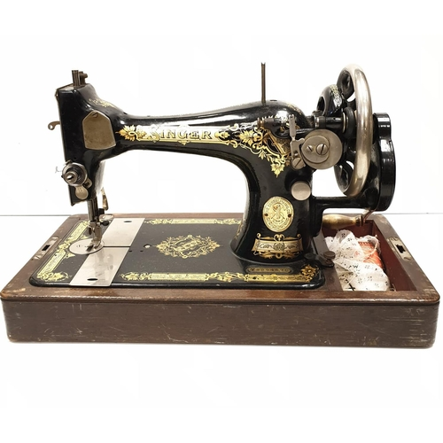 743 - Singer sewing machine classic black design with gold decoration circa 1910 with hand turned mechanis...