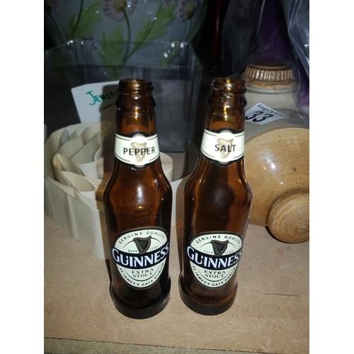40 - 2 salt & Pepper guinness bottle ornaments...