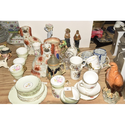 45 - A large quantity of various ceramics  To include two Staffordshire dogs, a cut glass vase, a Beswick...