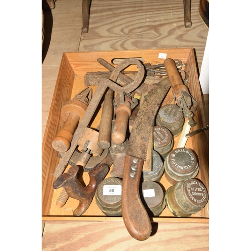 50 - A mixed group of various tools and ephemera  To include brass and wooden spirit level, 7 brass hub c...