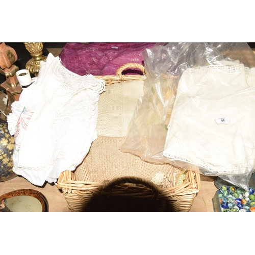 52 - A quantity of cotton and lace table linen  To include various embroidered floral design table cloth,...