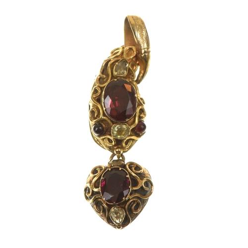 22 - A mid Victorian gem-set snake pendant Designed as a snake head, with garnet crest and eyes, suspendi...