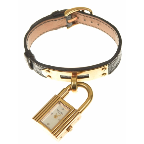 29 - An 18ct gold limited edition Hermès Kelly wristwatch The 18ct gold case designed as a padlock, with ...