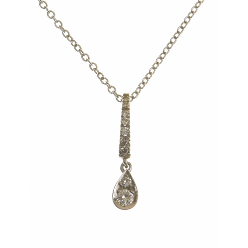 31 - An 18ct gold diamond pendant The brilliant cut diamond duo within a pear shape setting, suspended fr...