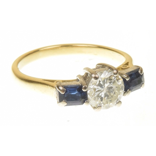 34 - An 18ct gold diamond and sapphire three stone ring The brilliant cut diamond with rectangular shape ...