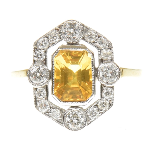 5 - A sapphire and diamond cluster ring The rectangular shape yellow sapphire within a brilliant cut dia...