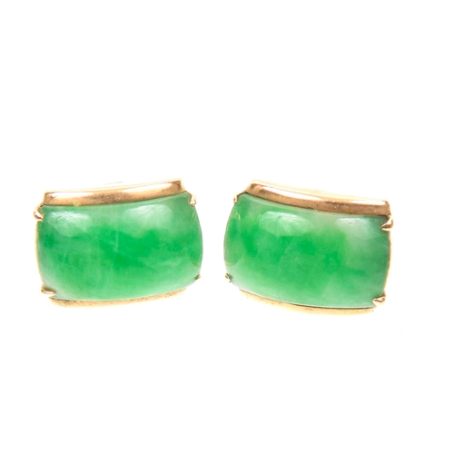 57 - A pair of jade stud earrings Each designed as a rectangular convex jade panel with curved bar sides,...