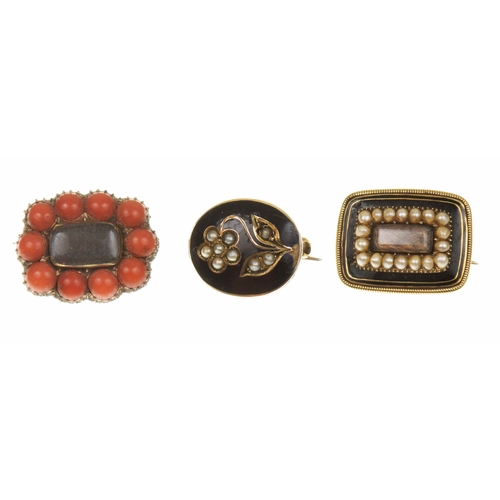 8 - Three mid Victorian memorial brooches To include a split pearl forget-me-not within an oval shape bl...