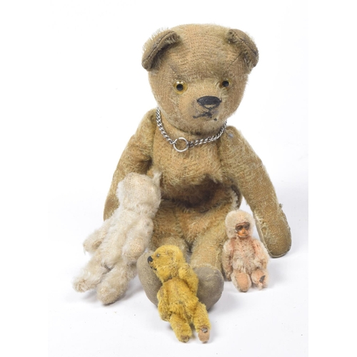 10 - A golden brown plush teddy bear purse With glass eyes, pointed snout, articulated limbs, the purse w...