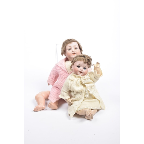 2 - Two German bisque headed dolls Comprising a doll with brown wig, open/shut brown eyes, open mouth, i...