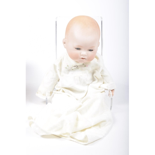 22 - A German bisque headed 'My Dream Baby' doll by Armand Marseille With open/shut blue eyes, cloth body...