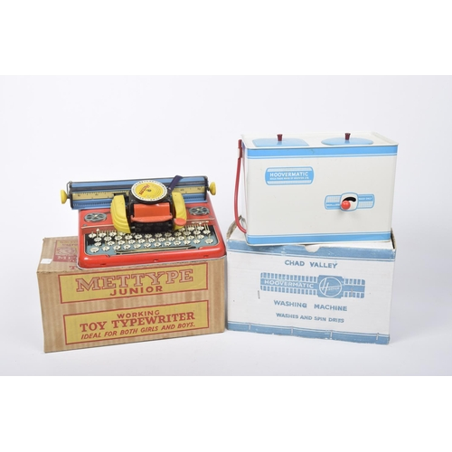 26 - A boxed Mettype Junior working toy tinplate typewriter And a boxed Chad Valley tinplate Hoover Matic...