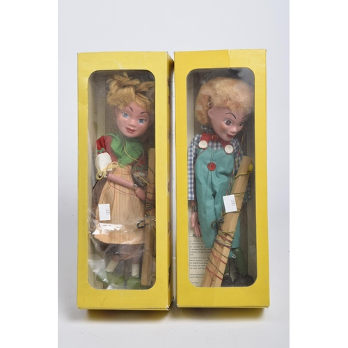 28 - Two boxed Pelham puppets Comprising SL Hansel and SL Gretel, both in yellow card boxes...