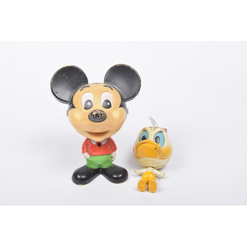 31 - Two 1970s plastic Disney figures Comprising a Mattel Inc. 1976 Mickey Mouse figure with pull string ...