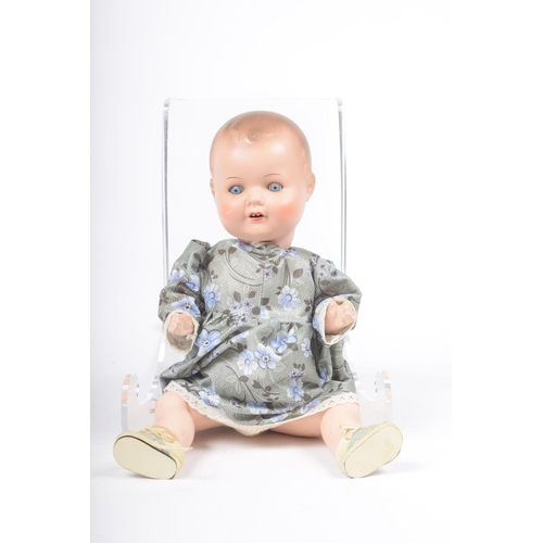 4 - A German bisque headed 'My Dream Baby' style doll With moulded hair, open/shut blue eyes, open mouth...