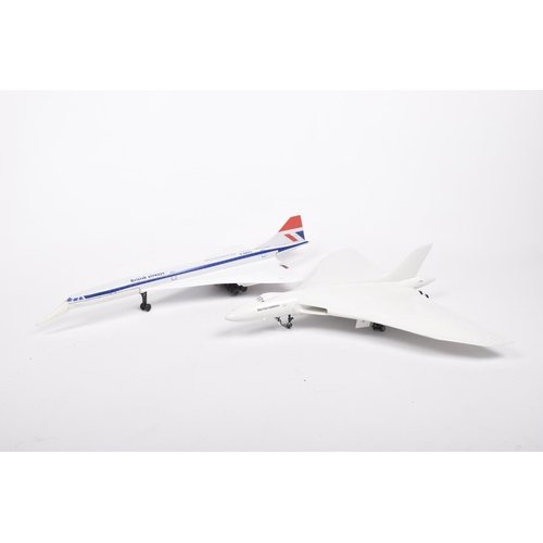 40 - A scale model of Vulcan Bomber In British Airways livery and a Joustra French model of a Concorde wi...