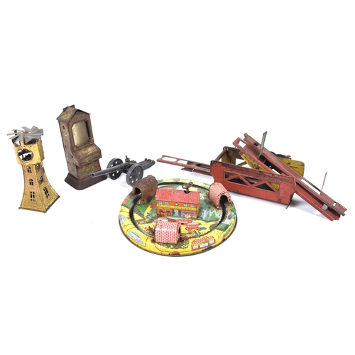50a - A quantity of tinplate items Comprising a clockwork train on circular track with tunnels, with detai...