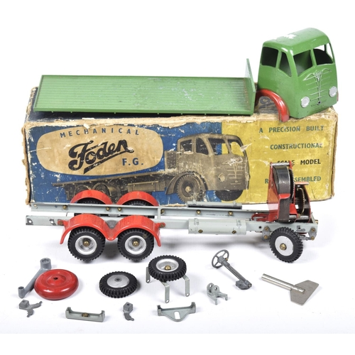 51 - A boxed Shackleton Toy mechanical Foden FG lorry With green cab and back with tail board, grey chass...