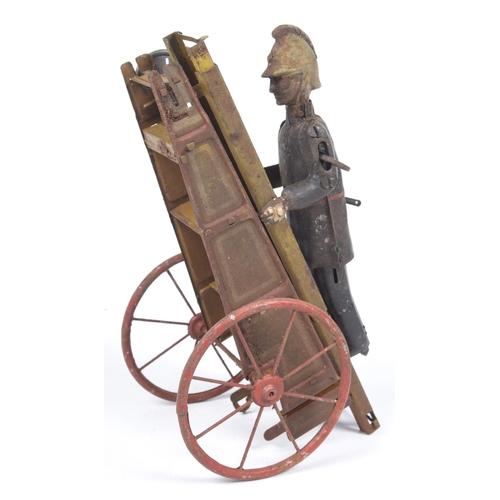 51a - A Gama tinplate clockwork fireman With extending ladder, height 26cm...