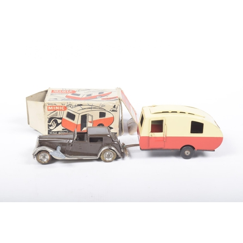 52 - A boxed Triang Minic caravan  In red and cream - box incomplete and an unboxed Triang Minic clockwor...