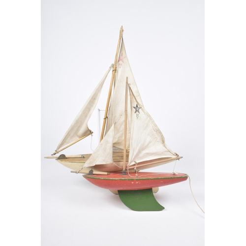 54 - Two wooden Star pond yachts One with white hull and plank effect decking, with single mast, the othe...