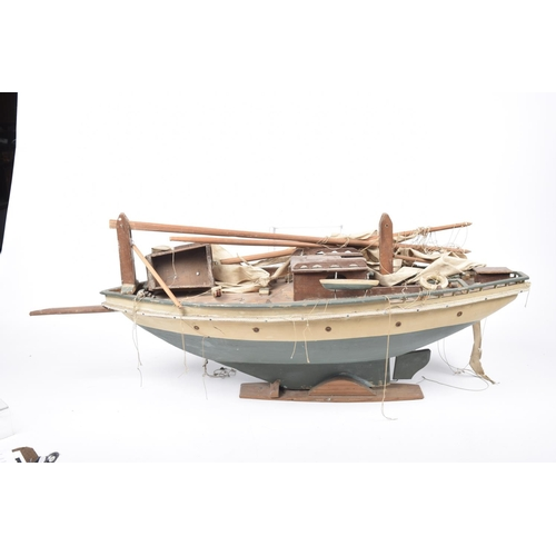 55 - A wooden pond yacht With green and cream hull, plank effect decking and stained wooden superstructur...