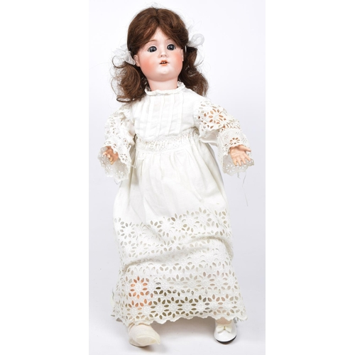 7 - A German bisque headed doll With dark brown wig, open/shut blue eyes, open mouth, impressed marks Ge...