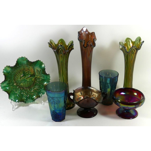 51 - A large collection of Carnival glass, to include three flared lip vases, a pair of blue tinted beake...