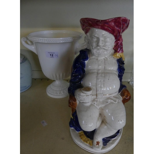 12 - A Royal Worcester double handled urn formed vase together with further Staffordshire character jug f...
