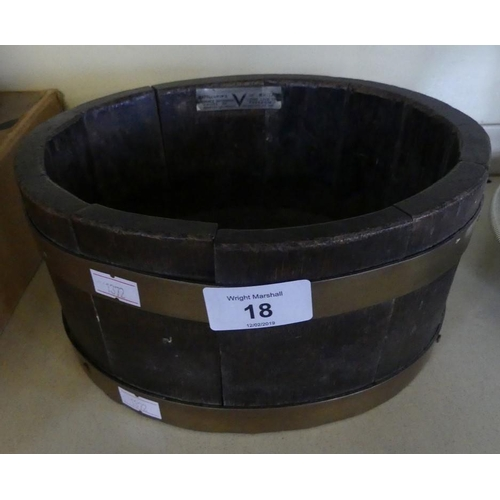 18 - A small circular oak and brass bound shot bucket, bearing plaque 'Battleships of Britain' and marked...