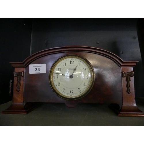 33 - Russells Ltd Manchester, an Edwardian mahogany cased mantel clock...