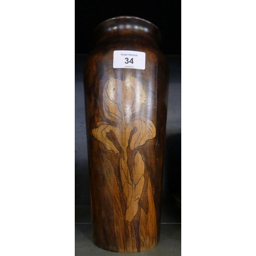 34 - A turned wooden vase decorated with pen work design of irises....