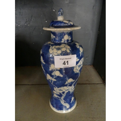 41 - A Chinese blue and white Prunus pattern covered baluster vase, four character mark to base....