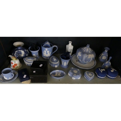 47 - A collection of Wedgwood Jasperware, to include various trinket boxes, teapot, commemorative mug, br...