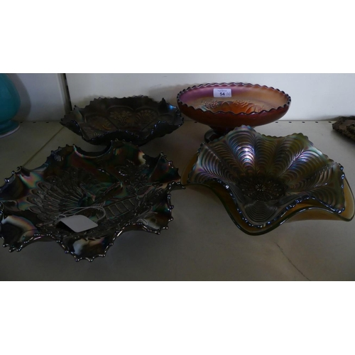 54 - A collection of Carnival glass Comprising four frilled rim dishes, one decorated with central design...