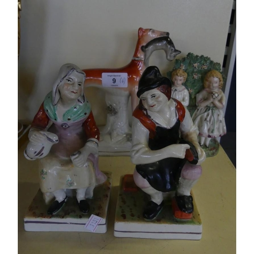 9 - A mixed lot of Staffordshire items comprising a pair of seated figures, a Bocage back model of two c...