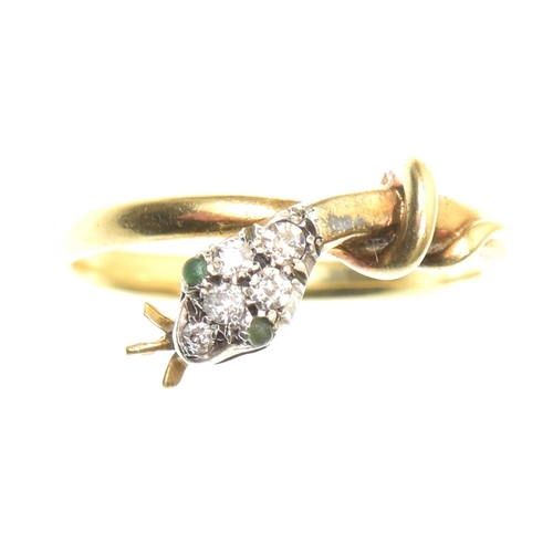 20 - A diamond snake ring Designed as a coiled snake, with green gem eyes, old cut diamond crest and an a...