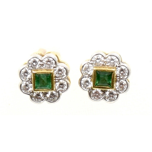 22 - A pair of 18ct gold emerald and diamond earrings Each designed as a square shaped emerald within a b...