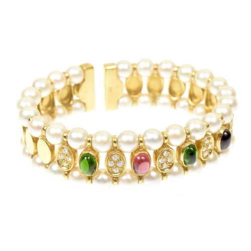 26 - A tourmaline diamond and cultured pearl bangle Of sprung design, the series of pink and green oval t...