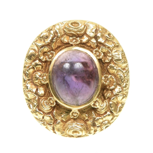 3 - A 1970s 9ct gold amethyst dress ring The oval amethyst cabochon within a floral surround, to the tap...