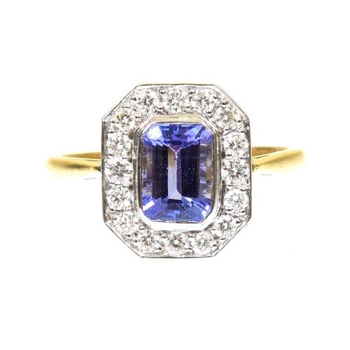 35 - A tanzanite and diamond cluster ring The rectangular shaped tanzanite within a brilliant cut diamond...