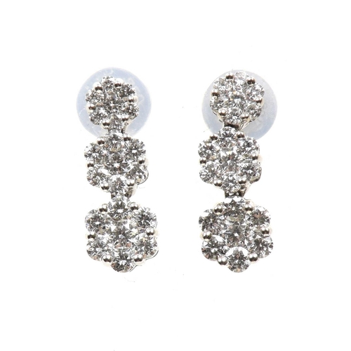 39 - A pair of diamond earrings Each designed as a series of graduated brilliant cut diamond clusters, es...