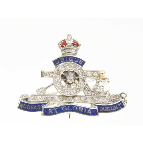 53 - An enamel and diamond Royal Artillery brooch The vari cut diamond and seed pearl set cannon with a b...