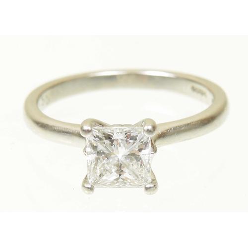 59 - A platinum diamond single stone ring The square shaped diamond within a four claw setting, hallmarks...